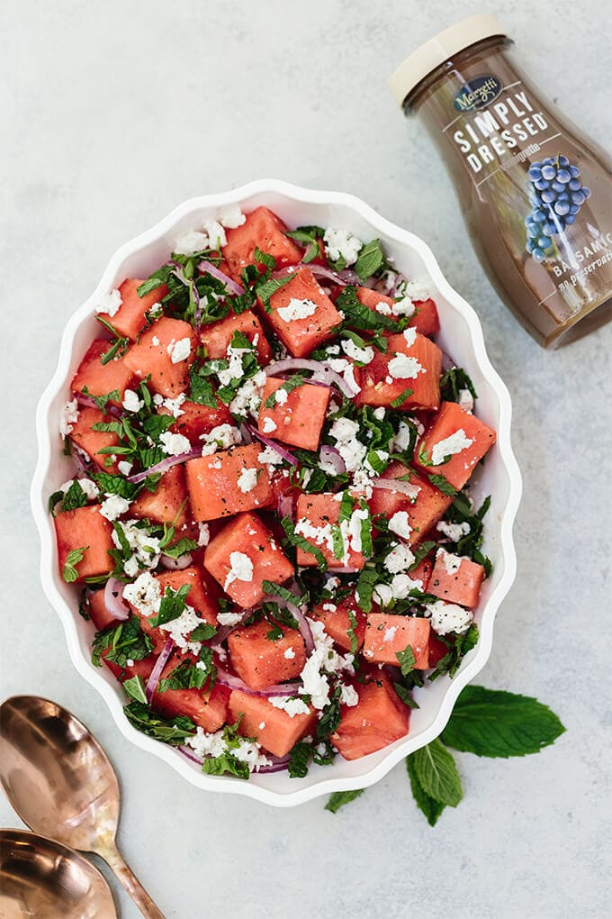 Watermelon Feta Mint Salad with red onion is a super refreshing summertime recipe. The simple balsamic dressing in this unexpected combination of flavors takes the salad to the next level. #ad #WFDRecipes
