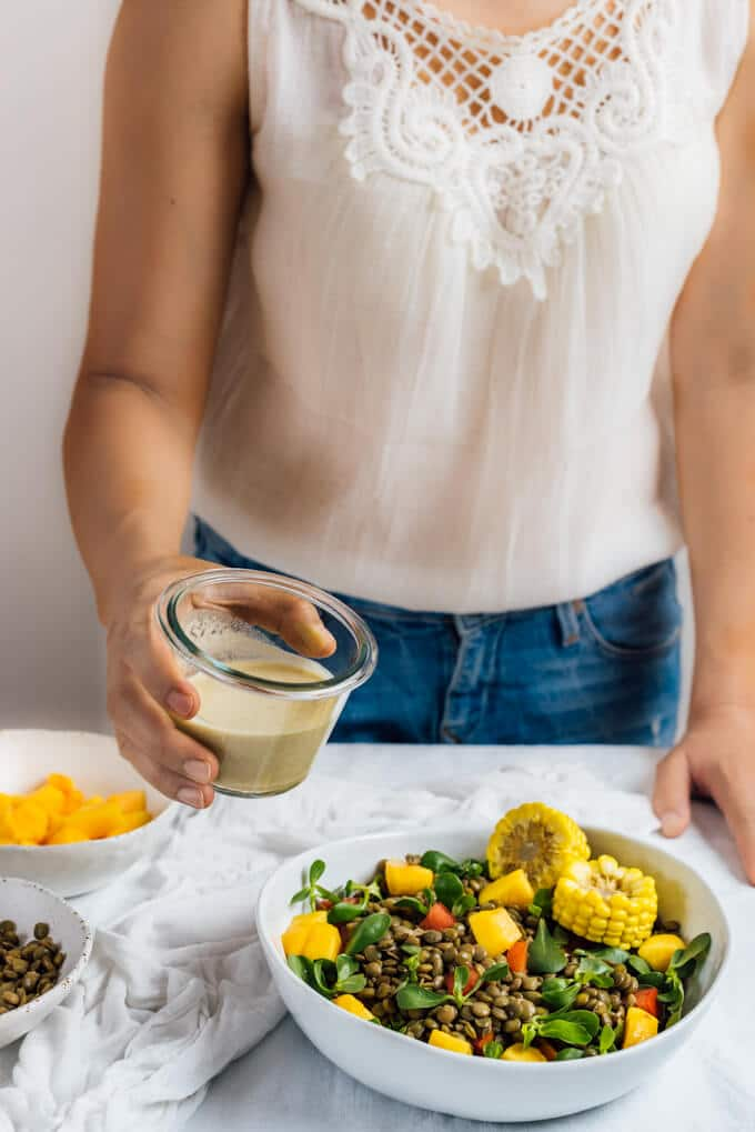 Cold Lentil Salad with Peaches is a refreshing and nutrition-packed summer meal. Tangy tahini dressing makes all the difference.