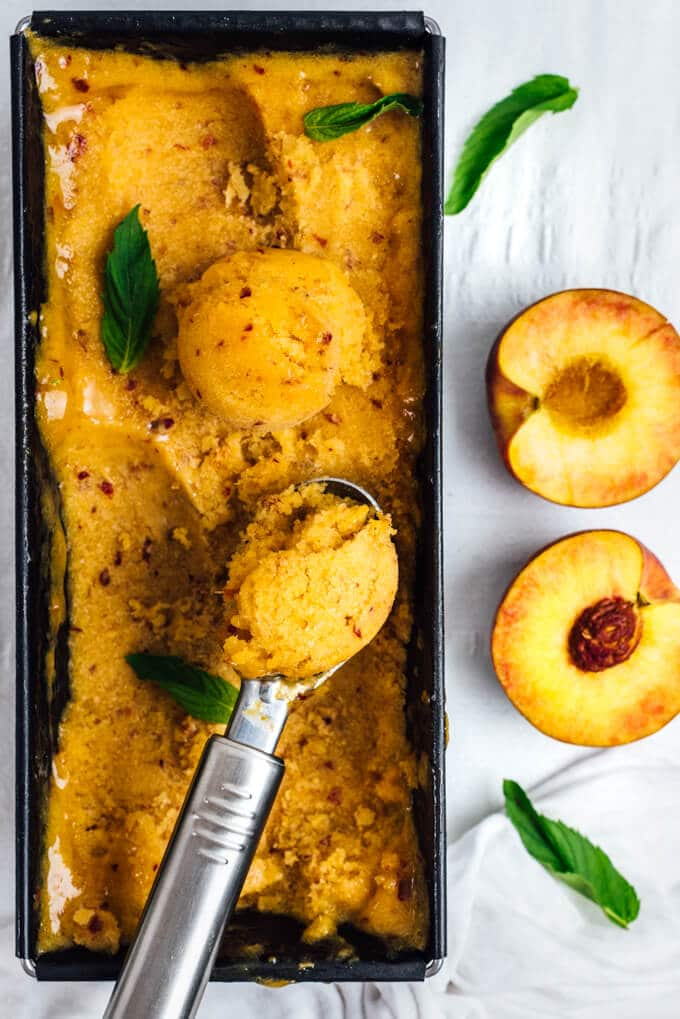Peach Sorbet is the best thing to use up ripe peaches in your fridge. You can make this easy, sweet and refreshing sorbet with 5 ingredients without an ice cream maker.