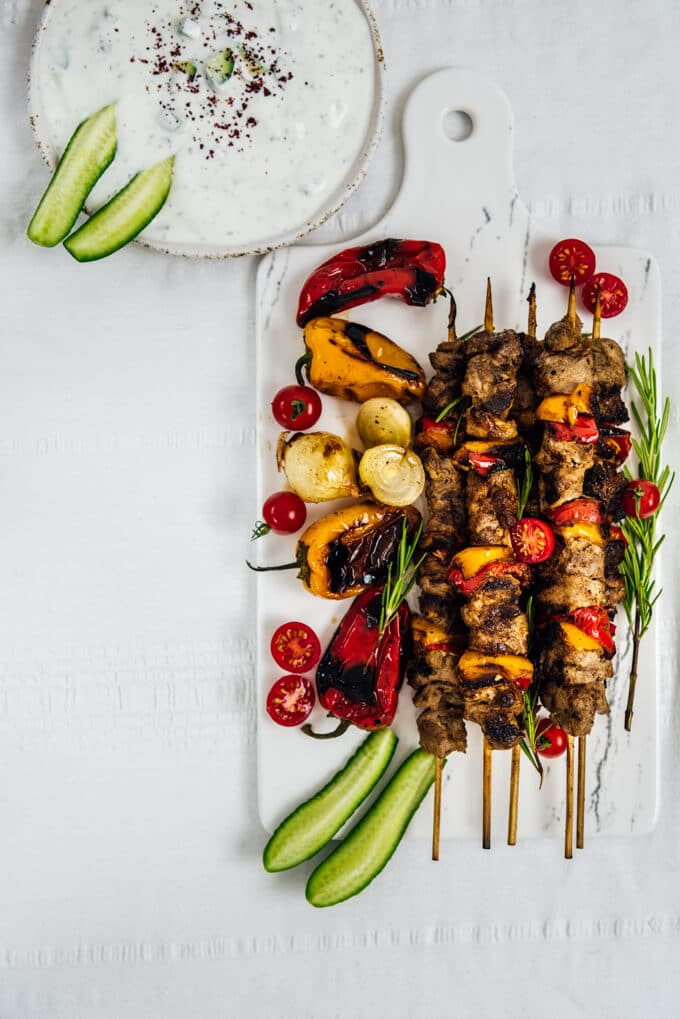 This Lamb Shish Kabob Recipe is a big hit on special occasions. The kabob is tender and juicy thanks to an easy yogurt marinade. Fancy yet simple and easy! Perfect for weeknight dinners too!