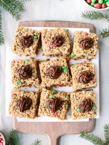 Peanut Butter Rice Krispies Treats topped with chocolate frosting. This is the easiest holiday treat ever! #sponsored