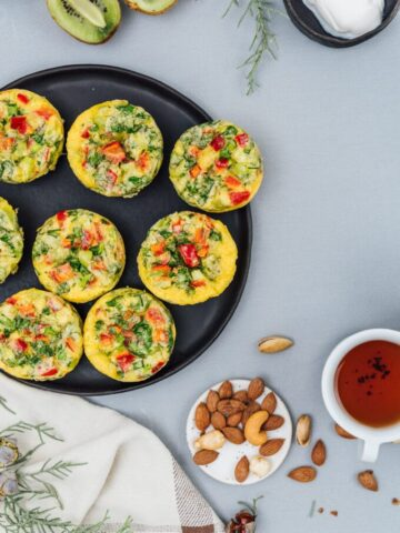 Looking for an easy and nutritious breakfast for your family? Loaded with cheese and herbs, these Vegetarian Breakfast Omelet Muffins keep you full until lunch time.