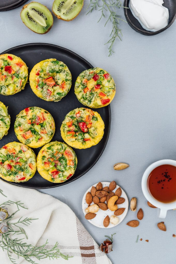 Vegetarian breakfast omelette muffins on a black plate