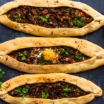Turkish pide with beef filling and an egg topping