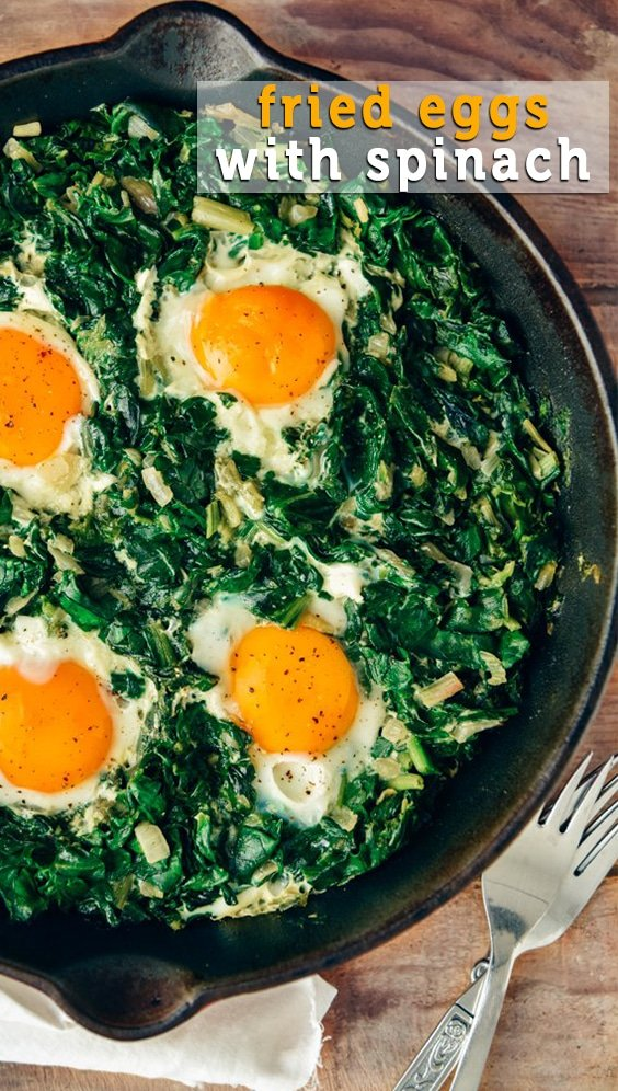 Fried Eggs with Spinach is an easy dish you can make in one pan. It is packed with great flavors and nutritious foods. Makes a delicious lunch or dinner that is ready in no time! #eggs #spinach #eggswithspinach