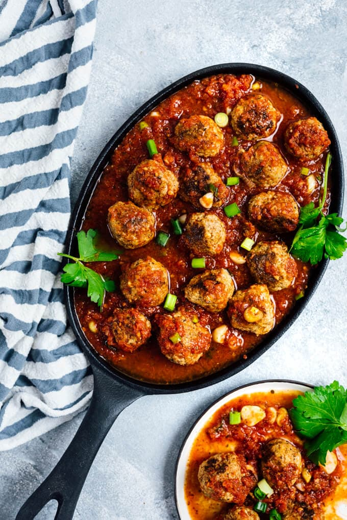 Tomato Chili Sauce Meatballs in a cast iron pan.