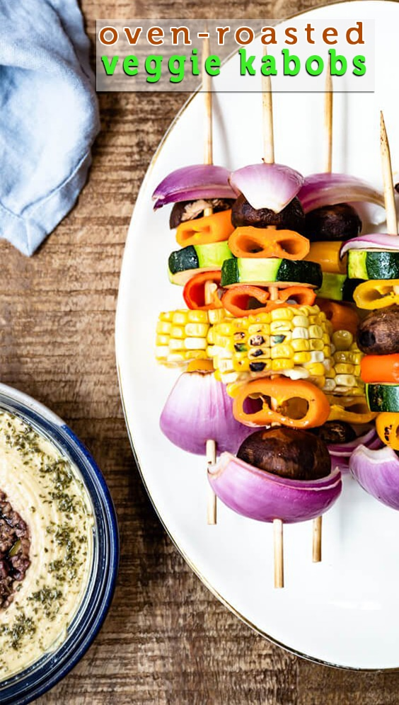 Oven-Roasted Veggie Kabobs with a simple tangy marinade are so tasty and healthy. So vibrant and packed with flavors, these kabobs make a a great side dish to any meal or a perfect summer appetizer. #vegetarian #kabobs #summerparty #partyfood #meatless #appetizer #ad @sabradips