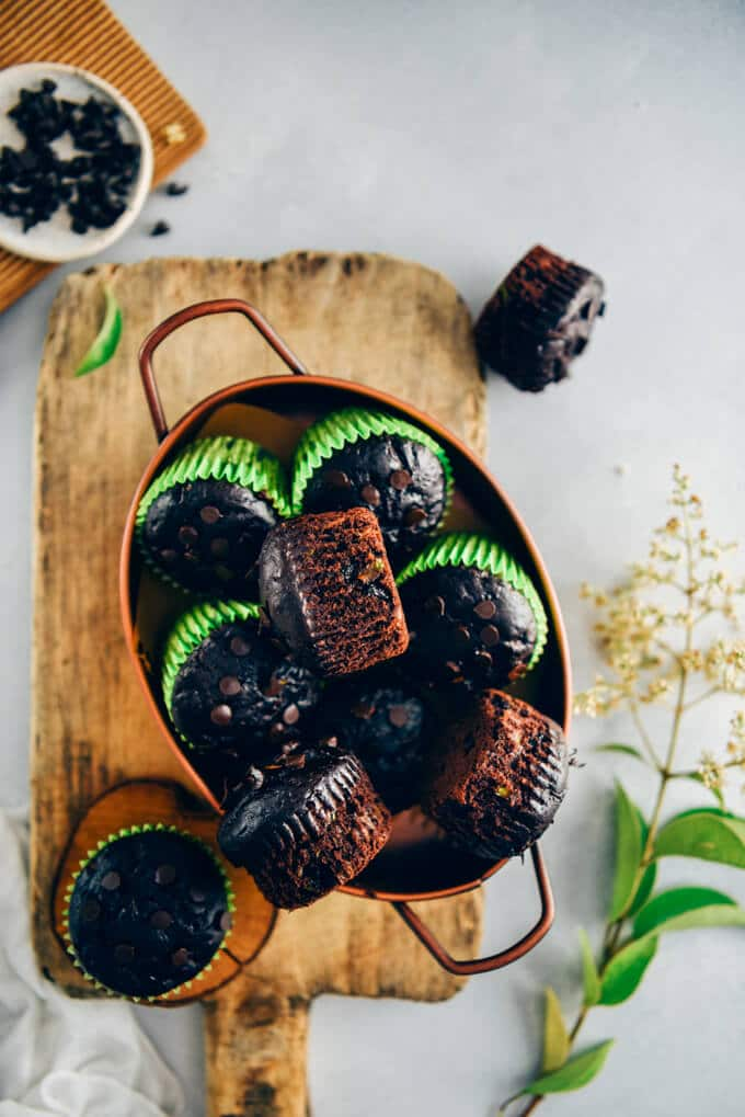 Healthy chocolate zucchini muffins in a copper pan