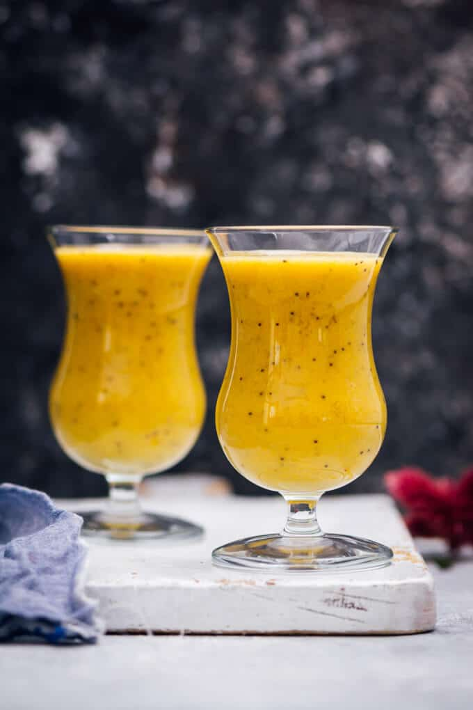 Golden milk smoothie with turmeric in two glasses