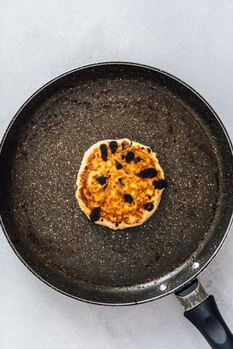 Cooking a pancake in a pan