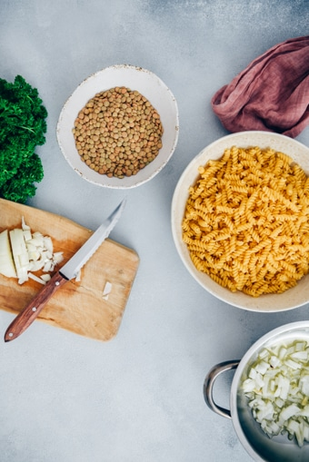 Vegan bolognese ingredients on a grey background