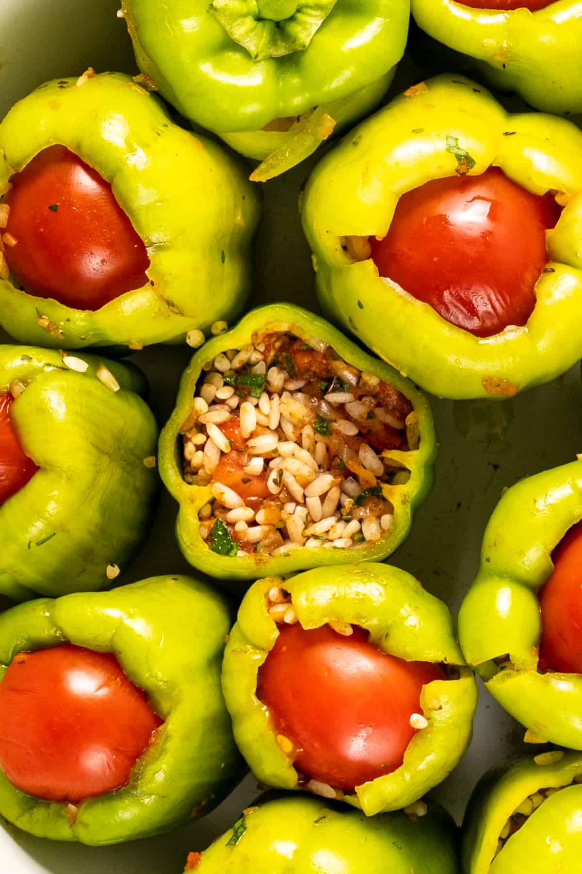 Green peppers stuffed with rice and topped with tomatoes.
