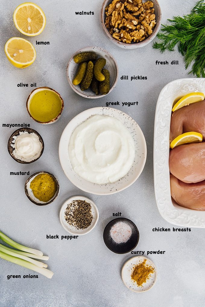 Low carb chicken salad ingredients on a grey background