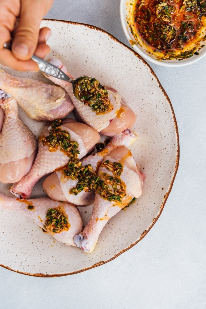 How to cook chicken legs in oven with herbs image