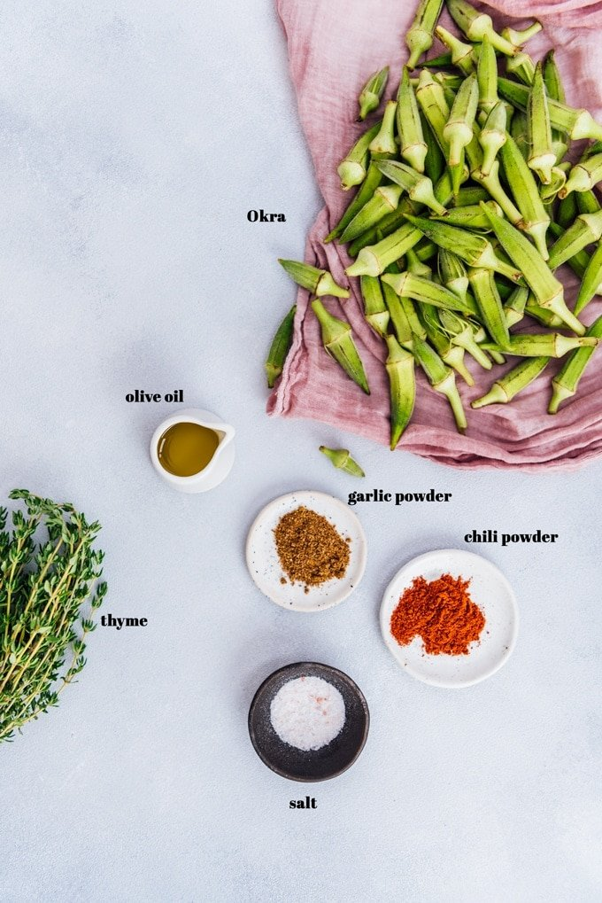 Roasted okra recipe ingredients on a light background.