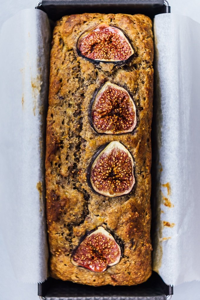 Easy banana fig bread topped with fresh fig slices in a loaf pan.