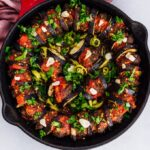 Turkish eggplant and meatball casserole in cast iron skillet