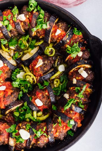 Meatball and eggplant casserole baked in a cast iron skillet