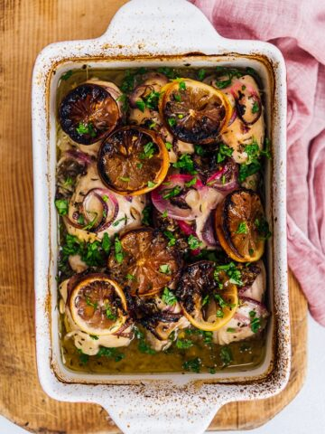 baked lemon chicken with onions in a casserole pan