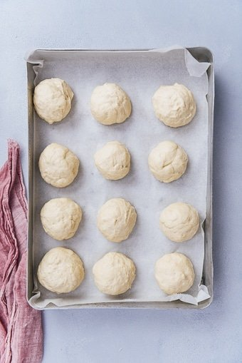 ball shaped dinner rolls in a baking pan