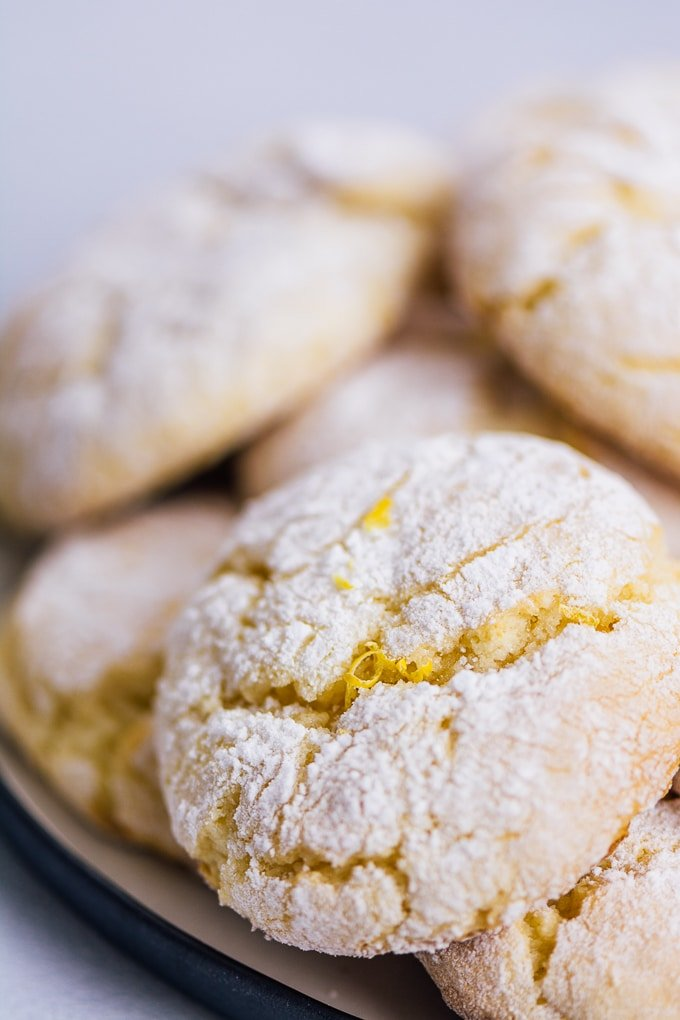 Close shot of lemon crinkle cookies on a plate.