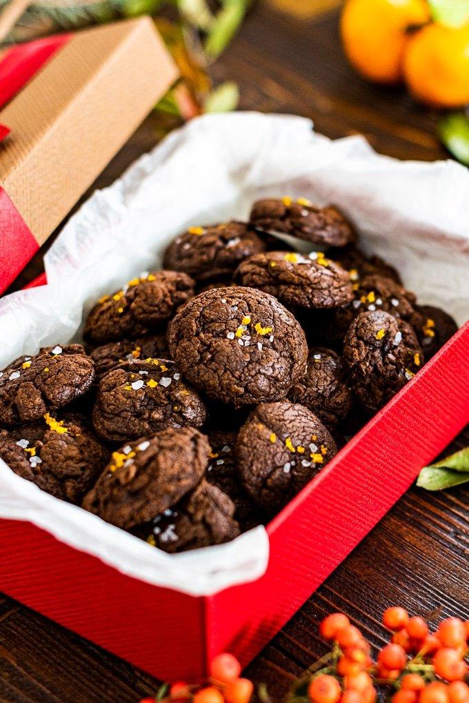Chocolate brownie cookies with orange zest and sea salt in a red gift box