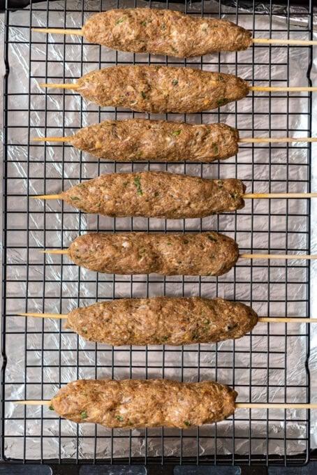 Roasting kefta kebab skewers in oven