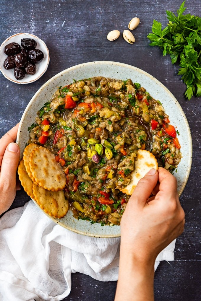 Dipping crackers into a bowl of baba ganoush without tahini.