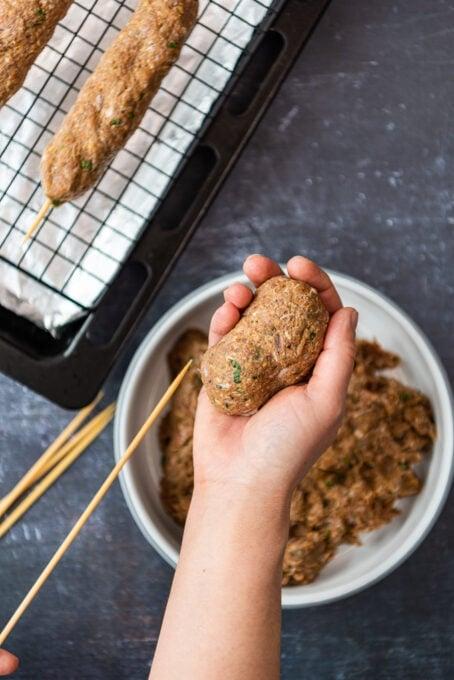 shaping kofta kebabs on wooden skewers