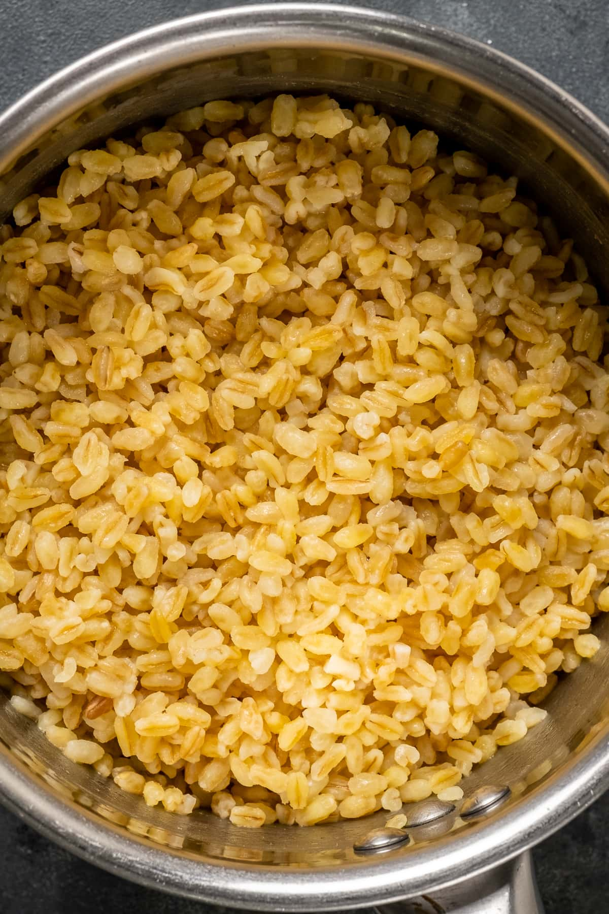 Very coarse bulgur in a saucepan after cooked.